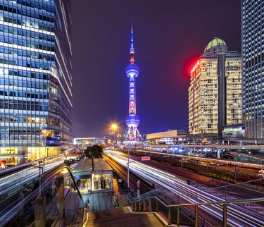 CH1405 The Oriental Pearl Radio & TV is a TV tower in Shanghai. Its location at the tip of Lujiazui in the Pudong district by the side of Huangpu River, opposite The Bund, makes it a distinct landmark in the...