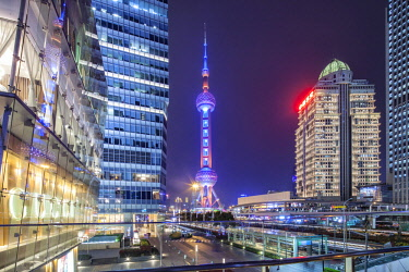CH1407 The Oriental Pearl Radio & TV is a TV tower in Shanghai. Its location at the tip of Lujiazui in the Pudong district by the side of Huangpu River, opposite The Bund, makes it a distinct landmark in the...