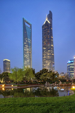 CH1410 Skyscrapers seen from Lujiazui Central Green Space, a green oasis in Pudong. From left to right: Shanghai World Financial Center, Jin Mao Tower, Shanghai Tower.