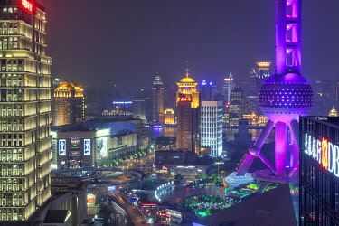 CH1415 Pudong seen from on of the skyscrapers with the highwalk on the left, the Oriental Pearl TV tower on the right and the historic Bund on the other side of the Huangpu River, China