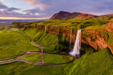 ICE4099AW Aerial drone view of Seljalandsfoss waterfall at sunset, Iceland