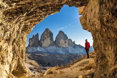 ITA113347AW Male hiker watching the Tre Cime di Lavaredo peaks or Drei Zinnen, Dobbiaco - Toblach, Trentino - Alto Adige or South Tyrol, Italy