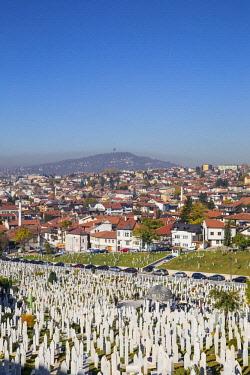 BH01171 Bosnia and Herzegovina, Sarajevo, View over Kovaci War Memorial and Cemetery to the City