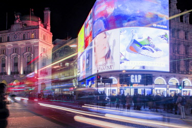 ENG15140AW A night shot of light trails in front of the advertising hoardings in Piccadilly Circus, central London, England, Great Britain