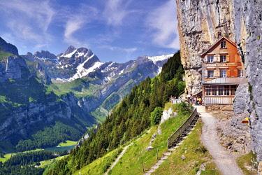 IBLDAB04160967 Mountain restaurant Aescher overlooking lake Seealpsee and Altmann mountain, Alpstein, Canton of Appenzell Inner Rhodes, Switzerland, Europe