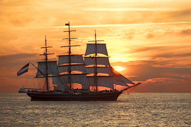 IBLEBA03986622 Evening sailing with the Stad Amsterdam in the foreground, Hanse Sail 2014, Warnemunde, Mecklenburg-Western Pomerania, Germany, Europe