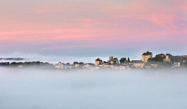 FRA10185AW Curemonte labelled l'un des plus beaux villages de France (most beautiful villages in France) in the morning mist, Correze, Nouvelle-Aquitaine, France