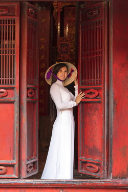 VIT1445AW Girl wearing Ao Dai dress and Non La conical hat, Temple of Literature, Hanoi, Vietnam