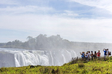 ZIM2698AW Africa, Zimbabwe, Matabeleland north. Tourists photographing the Victoria Falls