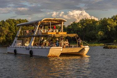 ZIM2706AW Africa, Zimbabwe, Matabeleland north. Sunset cruise on the Zambezi near to Victoria Falls