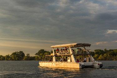 ZIM2707AW Africa, Zimbabwe, Matabeleland north. Sunset cruise on the Zambezi near to Victoria Falls