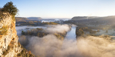 FRA10194AW Aerial view of the Dordogne Valley & Dordogne river on a misty morning in autumn,  Lot, Midi-Pyrenees, France