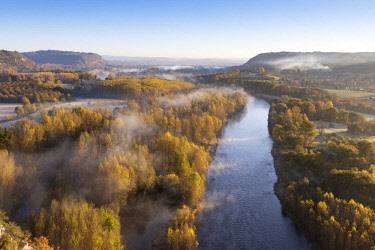 FRA10195AW Aerial view of the Dordogne Valley & Dordogne river on a misty morning in autumn,  Lot, Midi-Pyrenees, France