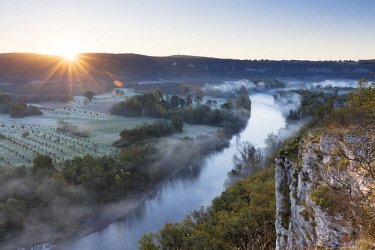FRA10197AW Aerial view of the Dordogne Valley & Dordogne river on a misty morning in autumn,  Lot, Midi-Pyrenees, France