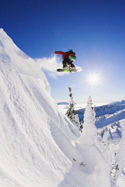 ARCLAD000387 Snowboarder performing a 180 jump while snowboarding, Revelstoke, British Columbia, Canada