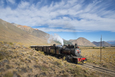 ARFEMR001038 Clouds over train crossing Old Patagonian Express railway, Esquel, Chubut, Argentina