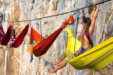ARWASE001037 People sleeping in hammock and hanging on high line above mountains, Tijesno Canyon, Banja Luka, Bosnia and Herzegovina