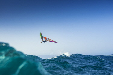 ARVISE002917 Professional windsurfer in mid-air, El Cabezo, Tenerife, Canary Islands, Spain