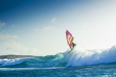 ARVISE002919 Professional windsurfer jumping over wave, El Cabezo, Tenerife, Canary Islands, Spain