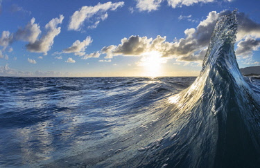 Two waves colliding in early morning light of dawn, East side of Oahu, Hawaii, USA