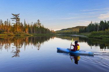 ARESJO001156 Person kayaking on St. Regis River in Adirondack Park, New York, USA