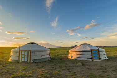 CLKFV74148 Mongolian nomadic traditional gers at sunset. Middle Gobi province, Mongolia.