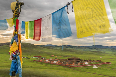 CLKFV74439 Amarbayasgalant Monastery from above framed by prayer flags. Mount Buren-Khaan, Baruunburen district, Selenge province, Mongolia.
