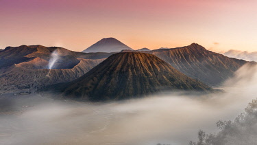 CLKMG71239 Sunset in Bromo with mist, Giava island