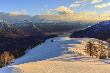 CLKRG74119 Ski mountaineer on Monte Olano at sunrise, Gerola Valley, Sondrio province, Valtellina, Lombardy, Italy