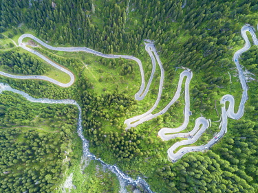 CLKRM72619 Aerial view of curves of the road between woods, Maloja Pass, Bregaglia Valley, canton of Graubunden, Engadine, Switzerland