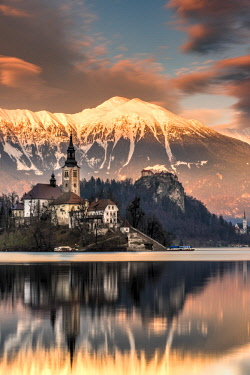 SLO1253AW Winter sunset over Church of the Assumption of Mary, Lake Bled, Upper Carniola, Slovenia