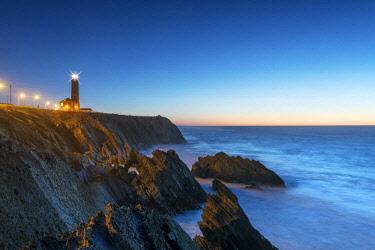 POR9704AW The rocky coast of Sao Pedro de Moel at sunset. Marinha Grande, Leiria. Portugal