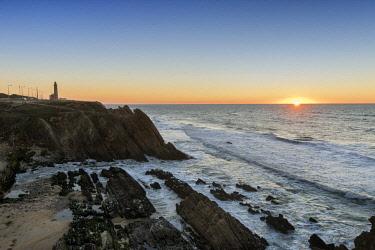 POR9705AW The rocky coast of Sao Pedro de Moel at sunset. Marinha Grande, Leiria. Portugal