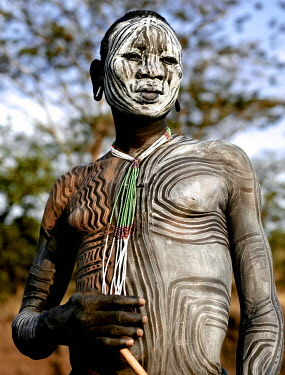 ETH3411AW Africa, Ethiopia, Omo Valley.  Man of the Suri tribe with elaborate body painting