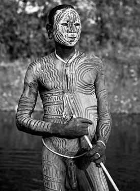 ETH3412AW Africa, Ethiopia, Omo Valley.  Man of the Suri tribe with elaborate body painting