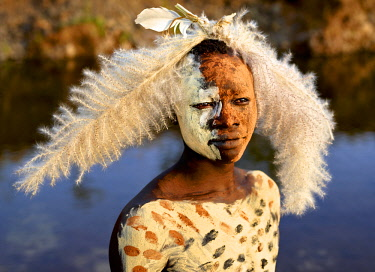 ETH3413AW Africa, Ethiopia, Omo Valley.  Man of the Suri tribe with elaborate body painting