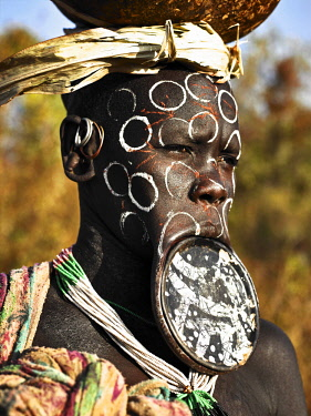 ETH3417AW Africa, Ethiopia, Omo Valley.   Mursi woman with lip plate and face painting