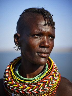 KEN10481AW Africa, Kenya, Lake Turkana.  A Turkana woman with layers of beaded necklaces