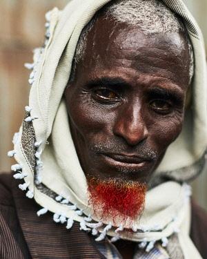 KEN10493AW Africa, Kenya.  A Muslim man with a headscarf and  henna-ed beard