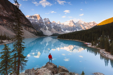 CAN3221AW Tourist looking at Moraine lake at sunrise, Banff National Park, Alberta, Canada (MR)