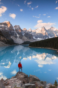 CAN3222AW Tourist looking at Moraine lake at sunrise, Banff National Park, Alberta, Canada (MR)
