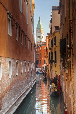 ITA11450 Italy.Veneto.Venice. The campanile di San Marco visible from a canal with gondolas.