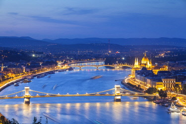 HUN1565 Hungary. Budapest. Overview of the City across the River Danube with the Houses of Pariliament, Castle Hill and Szechenyi Chain Bridge.