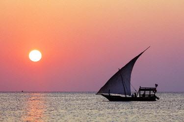 TZ3505 East Africa, Tanzania, Zanzibar island; Nungwi Beach, Dhow sail boat at sunset