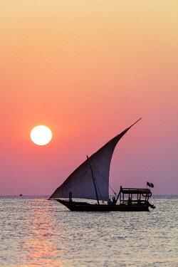 TZ3506 East Africa, Tanzania, Zanzibar island; Nungwi Beach, Dhow sail boat at sunset