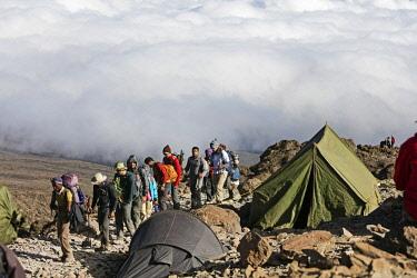 TZ3559 East Africa, Tanzania, Kilimanjaro (5895m) National Park, Unesco World Heritage site, hikers arriving at Barafu campsite