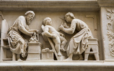ITA11603 Florence, Tuscany, Italy. A carving on the exterior of the Orsanmichele Church depicting the activities of the City's trade guilds such as the Carpenters and Stone Masons.
