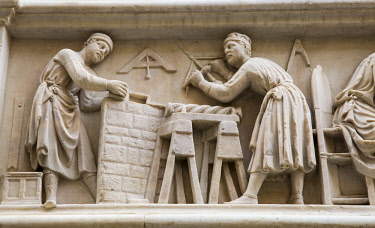 ITA11604 Florence, Tuscany, Italy. A carving on the exterior of the Orsanmichele Church depicting the activities of the City's trade guilds such as the Carpenters and Stone Masons.