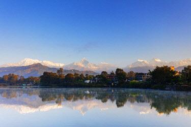 NEP2363 Asia, Nepal, Pokhara, views of Annapurna mountain range reflected in Lake Phewa