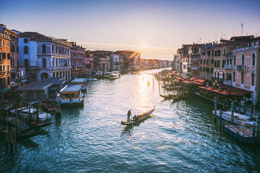 ITA11666AW Venice, Veneto, Italy. Gondola in Grand Canal at sunset from Rialto bridge.